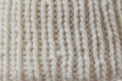 Stirnband NUNIQ Schurwolle handgestrickt